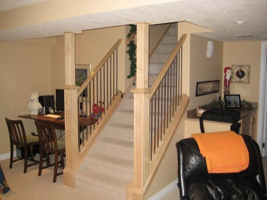 A staircase featuring pillars installed by Refine Renovations