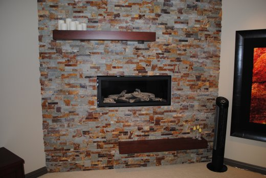 A fireplace centred in a brick wall installed by Refine Renovations