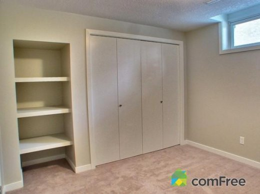 Closet and built-in shelf installation by Refine Renovations