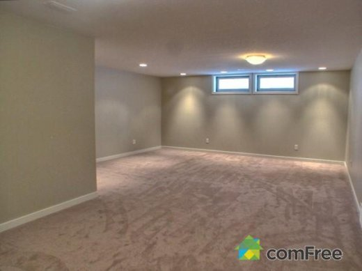 A basement room renovated by Refine Renovations
