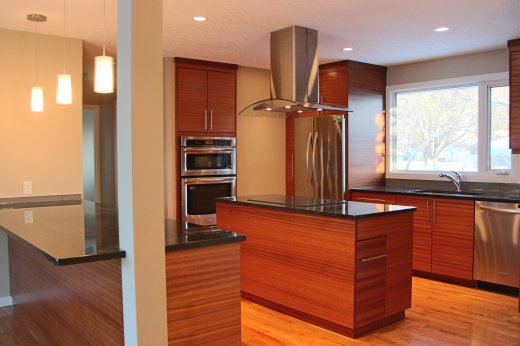 Kitchen renovation featuring two islands by Refine Renovations